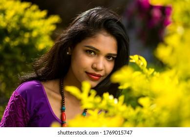Beautiful Indian young girl posing outdoors or park.