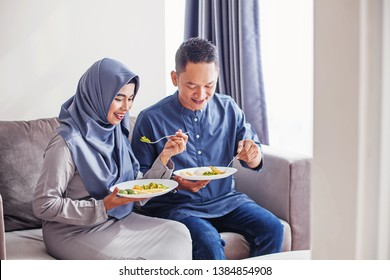 Beautiful indonesian couple eating together