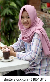 beautiful Indonesian Muslims were enjoying ice cream, juices, food with an abstract background