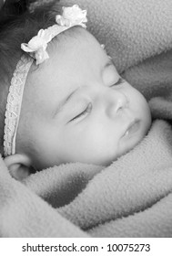 A beautiful infant sound asleep. family, love, childhood
