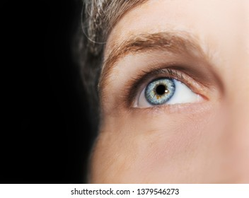 A beautiful insightful look eye. Close up shot. The eye of an elderly woman.