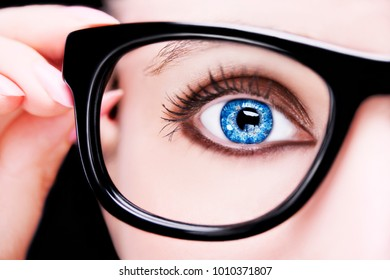 A beautiful insightful look woman's eye. Woman wearing glasses. Close up shot