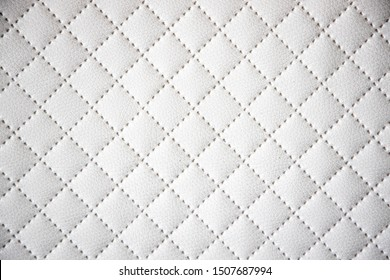 beautiful interesting original white leather background with quilting pattern