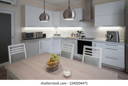 Beautiful interior apartment kitchen. Modern style. Design background. Home decoration. Nature materials. White, gray, beige color. Minimalism view. Fashion luxury room.