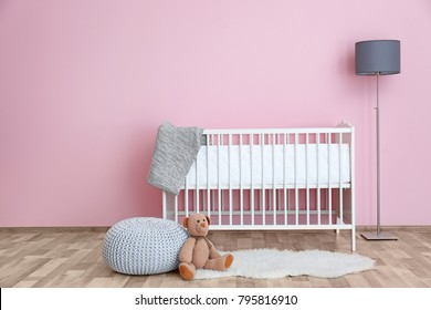Beautiful interior of baby room with white crib