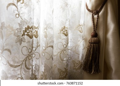 Beautiful interior decoration of a curtain and tassel