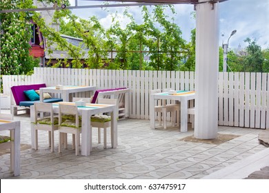 Beautiful interior of the outdoor restaurant of white wood