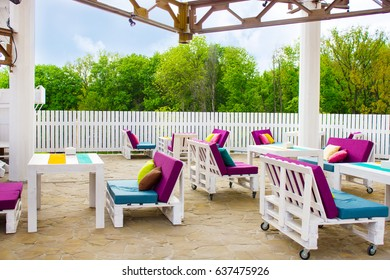 Beautiful interior of the outdoor restaurant with  white wood furniture