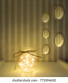 Beautiful interior vintage style with Christmas lights in a glass jar and five oval little mirrors