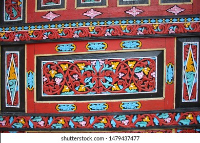 Beautiful intricate wood carving on the exterior of Minangkabau tribe tarditional house in West Sumatra, Indonesia