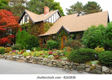 Beautiful and inviting New England cottage with colorful landscaping