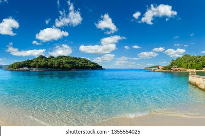 Beautiful Ionian Sea with clear turquoise water and morning summer coast. View from Ksamil beach, Albania.Two shots stitch panorama.