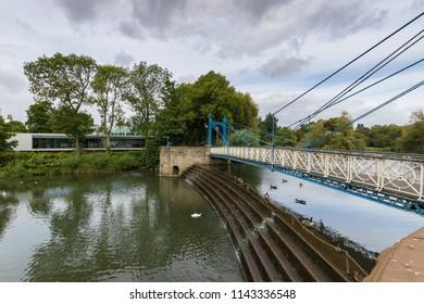Beautiful Ironwork footbridge over the River Leam at Jephson Gardens, Leamington Spa, Warwickshire, August 2017
