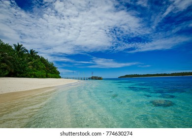 The beautiful island of the Mentawai in West Sumatra , Indonesia with white sand beaches, tropical lush and turquoise reefs it makes this destination the perfect luxury escape.