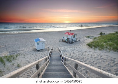 beautiful island Sylt - long wooden stairway to the sea at sunset