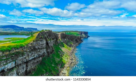 Beautiful Isle of Skye in Scotland with its green hills and rocky cliffs