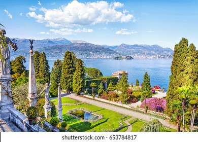 Beautiful Isola Bella island with flower garden on Lake Lago Maggiore in the background of the Alps mountains, Stresa, Italy