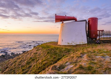 A Beautiful Isolated seascape with bright red fog horn on the Coastline of Aberdeen early on a March morning