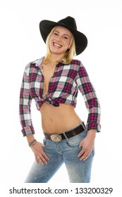 beautiful isolted blond cowgirl with jeans and cowboy hat