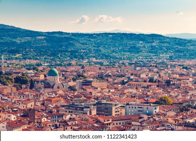 Beautiful italian town Florence with narrow lanes and old roofs, aerial view