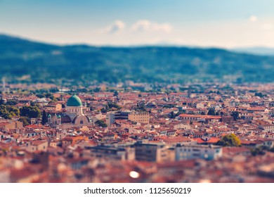 Beautiful italian town Florence with old roofs with tilt-shift effect