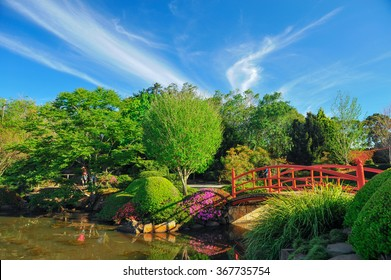 Beautiful japanese garden and a red wooden bridge under blue sky at Toowoomba, Queensland, Australia