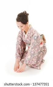 Beautiful japanese kimono woman sit in white background