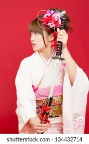 Beautiful japanese kimono woman with japanese sword