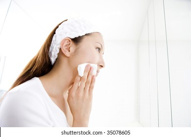 A beautiful Japanese woman doing her skin care