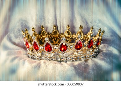 Beautiful jewel crown with ruby and diamond stones on velvet with color and blur effects/Jewelry crown/decoration item