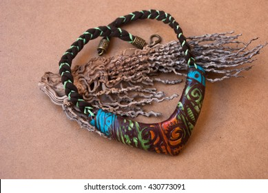 Beautiful jewelry bib necklace in african style. Handmade necklace of polymer clay.