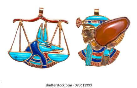 Beautiful jewelry with semiprecious stones, lapis lazuli, carnelian,  necklaces for woman in a shape of the ancient Egyptian god of death Anubis and Aquarius symbol, ancient egypt design