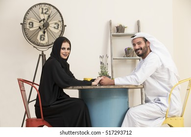 Beautiful and Joyful Arabian Couple holding hands and looking at the camera, relationship concept, happy arabic modern family concept