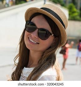 Beautiful joyful young woman enjoying her Paris travel. Fashion young blonde woman portrait