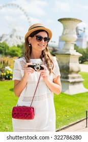 Beautiful joyful young woman enjoying her Paris travel. Fashion young blonde woman portrait