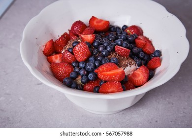 Beautiful juicy ripe natural organic raspberry, blackberry, blueberry lie on a white plate, healthy food diet sweet delicious vitamin for breakfast fresh dessert organic natural ingredients.