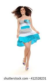 Beautiful jumping girl in summer dress
