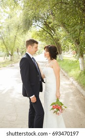 Beautiful just married couple outdoors