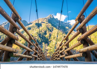 Beautiful The Kappa suspension wooden bridge with the Hotaka mountains behind at Kamikochi in the Chubu Sangaku National Park , beauty of nature concept.