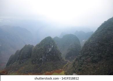 Beautiful karst foggy mountains in Dong Van Karst Plateau Geopark in Ha giang, Vietnam