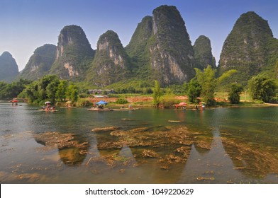 Beautiful Karst Mountain landscape with bamboo raft in Yangshuo, Guilin, China.