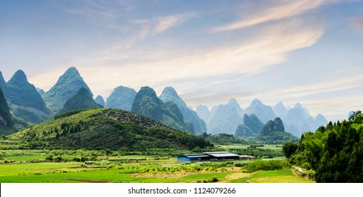 Beautiful karst mountains are visible on blue sky background on summer sunny day.