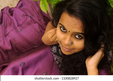 Beautiful Kerala Girl Woman Bride In Shining Dress With A Nose Ring Looks Up