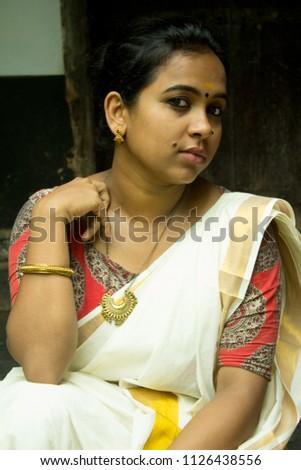 Beautiful Kerala Indian Girl Woman In Traditional Set Saree Kalamkari Blouse And Golden