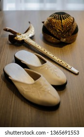 Beautiful Keris, Blangkon, and Sandals. Javanese Traditional Outfit, Indonesia.