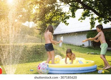 Beautiful kids having fun outside in the summer garden