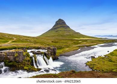 Beautiful Kirkjufell mountain with cloudy, Snaefellsnes peninsula, Iceland, selective focus