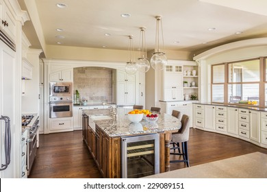 Beautiful Kitchen Interior in Luxury Home with Island, Hardwood Floors, and Elegant Cabinetry