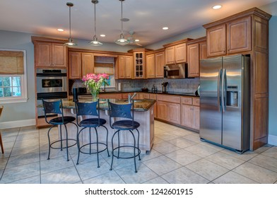 Beautiful kitchen with island and stainless steel appliances.