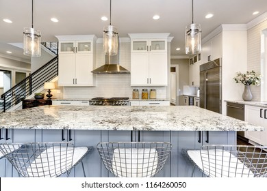 Beautiful kitchen in luxury modern home interior with island and